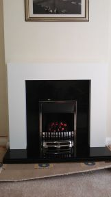 After rectifying the shoddy building work - supply and installation of fire and fireplace